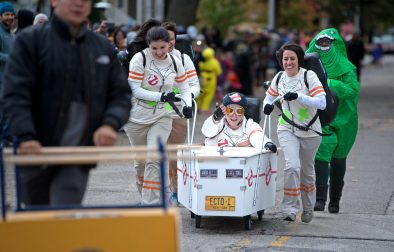 Teams race down the road on Saturday, Oct. 28, 2017, during the 6th annual Forest Park Chamber of Commerce Casket Races on Beloit Avenue, south of Madison Street in Forest Park, Ill. (ALEXA ROGALS/Staff Photographer)