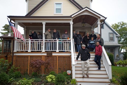 Attendees watch the races from a porch on Saturday, Oct. 28, 2017, during the 6th annual Forest Park Chamber of Commerce Casket Races on Beloit Avenue, south of Madison Street in Forest Park, Ill. (ALEXA ROGALS/Staff Photographer)