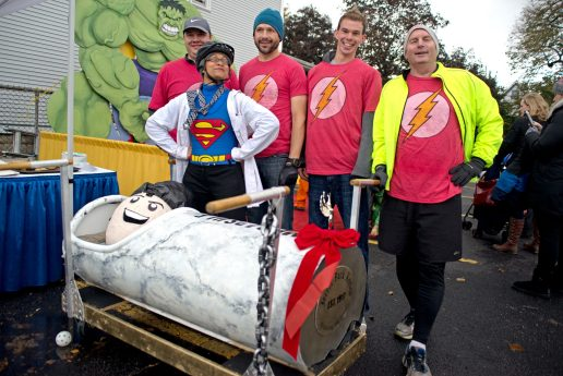 The Forest Park Review team stands for a photo behind their decorated casket on Saturday, Oct. 28, 2017, during the 6th annual Forest Park Chamber of Commerce Casket Races on Beloit Avenue, south of Madison Street in Forest Park, Ill. (ALEXA ROGALS/Staff Photographer)