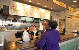 Cashier Janeth Flores gives Valerie White her pick up order at the new Tacabron restaurant on Harrison Street. | Alexa Rogals/Staff Photographer