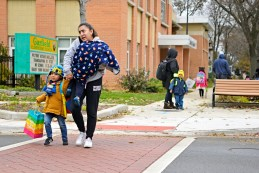 Pedestrians make there way across Jackson Boulevard after checking for cars at Garfield Elementary School in Forest Park.   Alexa Rogals/Staff Photographer