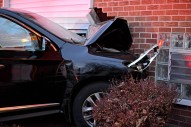 The from of the stolen Infinity SUV is seen with extensive damage after the vehicle was stolen in Elmhurst and crashed into an apartment complex on Wednesday, Dec. 20, 2017, on the 500 block of Jackson Boulevard in Forest Park, Ill. (Alexa Rogals | Staff Photographer)