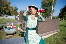 Lee Conte fixes her hat on Friday, Oct. 13, at the Forest Home Cemetery on Desplaines Avenue. | File photo
