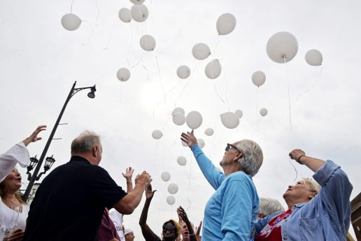 Attendees release white balloons into the air on Saturday, Aug. 26, during the anniversary celebration at Starship on Madison Street. | File photo