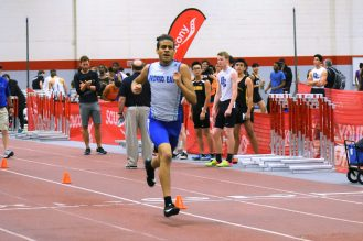 Donte Love competes in the 4x400 varsity relay. | Photo by Jill Wagner