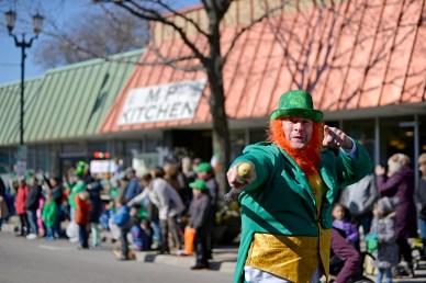 A participant dressed as a leprechaun walks along the route. | Alexa Rogals/Staff Photographer