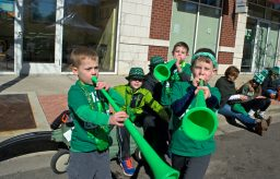 Parade-goers play with blow horns during the annual Saint Patrick's Day Parade on Madison Street in downtown Forest Park last Saturday. | Alexa Rogals/Staff Photographer