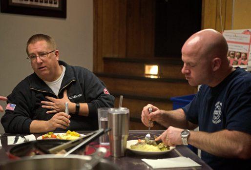 Fire Lieutenant Tim Conrad, left, talks with his crew. | Alexa Rogals/Staff Photographer