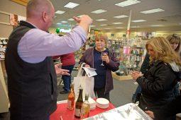 Participants learn about the different wines inside Schauer's Hallmark Shop. | Alexa Rogals/Staff Photographer