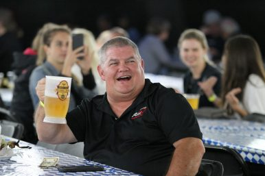 Ed Ebertsch, of Chicago, raises his beer mug and sings along as he listens to music, Friday, June 8 at Forest Park's German Fest.   Sarah Minor/Contributor
