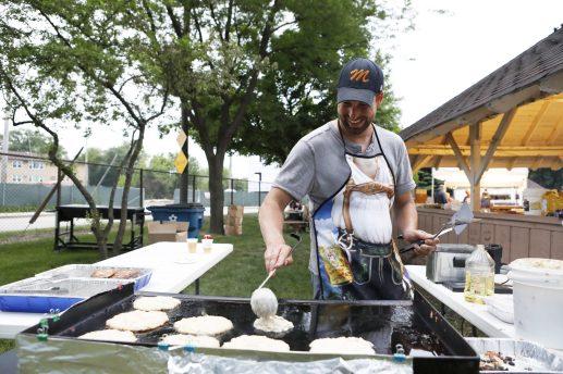 Pete Mantel, of Deutsch Amerikanischer National Kongress, cooks potato pancakes.   Sarah Minor/Contributor