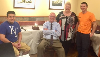 Kiwanis Club of Forest Park members celebrate its 95th anniversary with cake at Francesca Fiore's. Among those present to cut the cake were club members Jordan Kuehn, Jerry Lordan, Kiwanis Lieutenant Governor Deb Paliferro, and Steve Knysch. (File Photo)