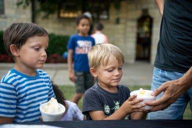 Brothers George, 5, left, and Eddie Dietz, 3, of Forest Park, look on excitedly at their cups. | Alexa Rogals/Staff Photographer