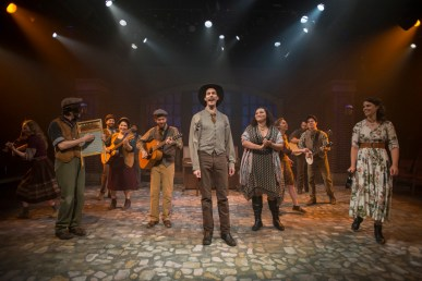 (left to right) Elleon Dobias, Joey Harbert, Mike Mazzocca, Sarah Beth Tanner, Eric Loughlin, T.J. Anderson, Erik Pearson, Bridget Adams-King, Melanie Vitaterna, Josiah Robinson, Kelan M. Smith and Amanda Giles in Underscore Theatre Company and The Den Theatre's new musical HAYMARKET. Photo by Michael Brosilow.