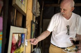 Artist Don Meyers, of Forest Park, talks about the different types of work he does. | Alexa Rogals/Staff Photographer