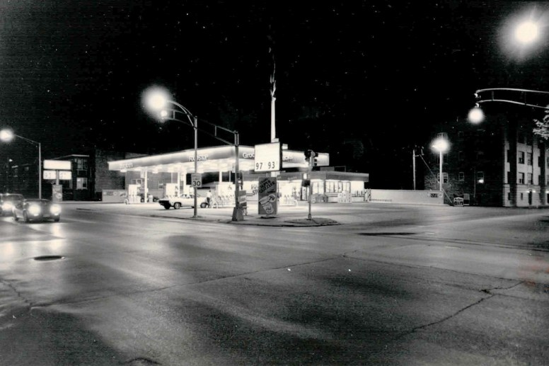 """In 1985 Thornton's re-opened the E-Z Go Gas station with a rainbow color scheme (this black and white photo leaves one to imagine). At night the store at Harlem and Jackson was said to look like a """"Forest Park Rainbow."""""""