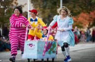 Team Alice in Wonderland race and cheer as they make their way down the street. | Alexa Rogals/Staff Photographer