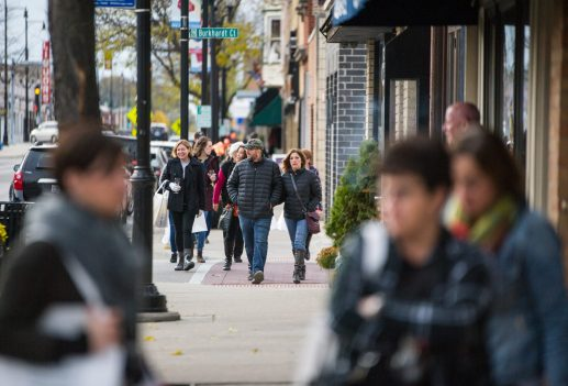 Participants walk down Madison Street during the Fall Wine Walk & Shop in Forest Park. | Alexa Rogals/Staff Photographer
