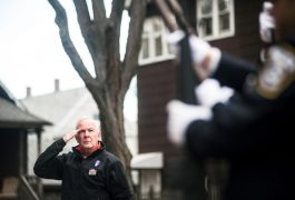 Michael Thompson salutes during the national anthem at an annual event of Veteran's Day in Forest Park on November 11, 2016.