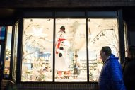 A snowman poses in the window at Creativita on Friday, Nov. 30, during the annual Holiday Walk in downtown Forest Park. | Alexa Rogals/Staff Photographer