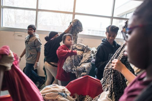 Students separate the clean bedding sheets. |Alexa Rogals/Staff Photographer