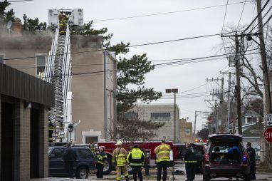 Firefighters from surrounding towns assist with the apartment building fire on Thursday, Jan. 10, 2019, on Hannah Avenue at the corner of Roosevelt Road in Forest Park, Ill. | ALEXA ROGALS/Staff Photographer