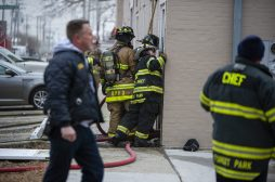 Firefighters gather around the opening to see inside the apartment building on Thursday, Jan. 10, 2019, on Hannah Avenue at the corner of Roosevelt Road in Forest Park, Ill. | ALEXA ROGALS/Staff Photographer