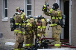 Firefighters gear up before entering the apartment building fire on Thursday, Jan. 10, 2019, on Hannah Avenue at the corner of Roosevelt Road in Forest Park, Ill. | ALEXA ROGALS/Staff Photographer