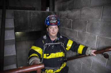 Firefighter Richie Gray stands in the stairwell with full gear on on Saturday, Jan. 12, 2019, inside the North Riverside Fire Department on Des Plaines Avenue. | Alexa Rogals/Staff Photographer