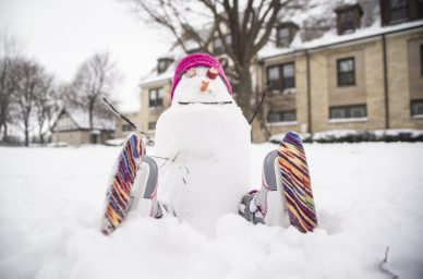 """A small snowman with ice-skates is seen """"sitting"""" on the ground on Saturday, Jan. 19, during a snowman building contest outside of the park district building on Harrison Street in Forest Park. 