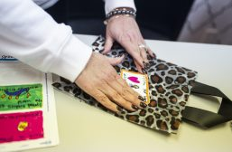 Girlicious owner Ivy Ippolito-Foreman adds the handmade labels to her shopping bags. | Alexa Rogals/Staff Photographer