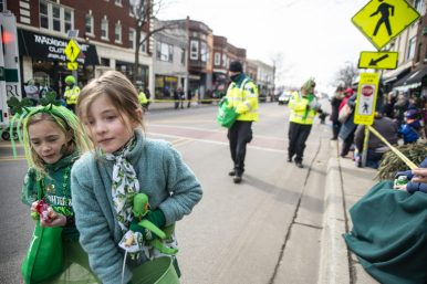Children hand out candy and treats to parade goers during the annual Forest Park St. Patrick's Day Parade on Madison Street throughout downtown Forest Park. | Alexa Rogals/Staff Photographer