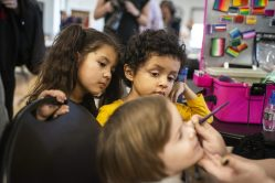 Siblings Rosabella Manzanares, left, and Jeremiah Manzanares, of Forest Park, wait in line and watch others get their face painted on Saturday, March 23, 2019, during the first Community and History Festival at the Park District of Forest Park on Harrison Street. | ALEXA ROGALS/Staff Photographer