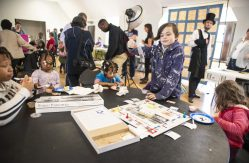 """A group of kids get ready to play """"Forest Parkopoly"""" on Saturday, March 23, 2019, during the first Community and History Festival at the Park District of Forest Park on Harrison Street. 