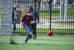 An officials team player kicks the ball. | Alexa Rogals/Staff Photographer