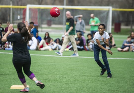 A player for the students team throws the ball to peg a runner. | Alexa Rogals/Staff Photographer