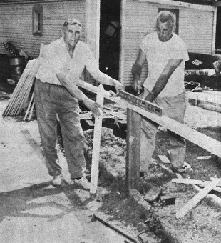 """""""Doss fence going up"""" is the caption on this front cover photo from May 14, 1964 Forest Park Review, featuring some of the improvements being made on private property around Forest Park for the Clean-up, paint-up, fix up campaign."""