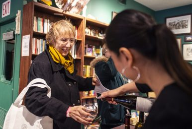 Marlaine McVisk, left, of River Forest, tries a sample of wine from Ideal Consumer Events representative Amy Tu, of Lisle, April 27, during the annual Spring Wine Walk and Shop on Madison Street throughout downtown Forest Park. | ALEXA ROGALS/Staff Photographer