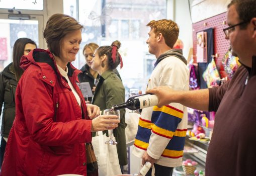 Attendees sample different types of wine on April 27, during the annual Spring Wine Walk and Shop on Madison Street throughout downtown Forest Park. | ALEXA ROGALS/Staff Photographer