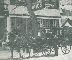 """Reprinted from May 8, 1952 Forest Park Review shows Otto's Restaurant with a horse drawn carriage """"adding nostalgic flavor to the Forest Park Chamber of Commerce Jubilee Celebration"""" that was scheduled mid May 1952. Otto's was famous as a restaurant and """"oasis"""" for Chicagoans who attended funerals at Forest home Cemetery. After the half day journey from Chicago to the cemetery, visitors and horses needed food and refreshments before heading back home. In the driver's seat is Henry J. Mohr and standing to the side the carriage is Gottlieb Schwab."""