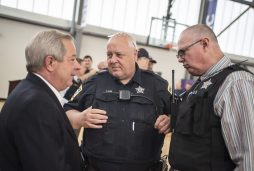 Outgoing mayor Anthony Calderone, left, talks with members of the Forest Park police department. | Alexa Rogals/Staff Photographe