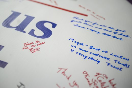 Attendees sign the thank-you banner during the Anthony Calderone Farewell party at Roos Recreation Center in Forest Park. | Alexa Rogals/Staff Photographer