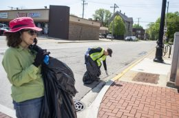 """Ellen Waterman, left, and Etta Worthington pick up trash from the street during a """"plalking"""", also known as picking up litter while walking along Madison Street in Forest Park. 