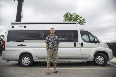 "Forest Park resident Scott Watson, standing in front of his live-in van named ""Lucy,"" has realized his dream of freedom. 