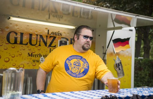 Jim Schwab, of Forest Park, serves up beer to attendees during the fifth annual German Fest at Altenheim Picnic Grove on Madison Street in Forest Park. | Alexa Rogals/Staff Photographer