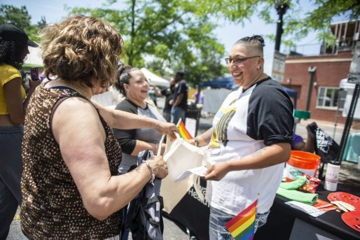 Attendees check out the Howard Brown Health Center booth on Saturday, June 22, during the first ever LGBTQIA+ Pride celebration at Constitution Court on Madison Street in downtown Forest Park. | ALEXA ROGALS/Staff Photographer