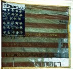"This battle worn flag of the Illinois 89th Infantry has stitched on it ""Clear the Track"" along with the battles the 89th fought in."