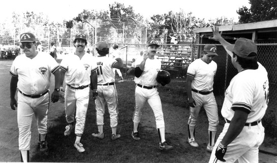 "circa 1992: Pitcher Pat Whealy (third from right) congratulated by team mates after he ""helps himself out"" with a home run."