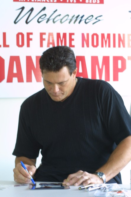 Dan Hampton signing autographs in the window of Trage.