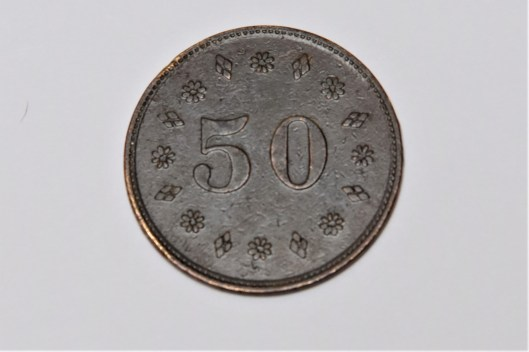 "The back of this token says ""50."""